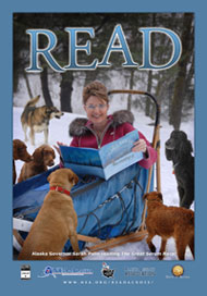 Actual 2008 NEA Alaska Poster: Governor Sarah Palin goes to the dogs — to encourage young people to read.*