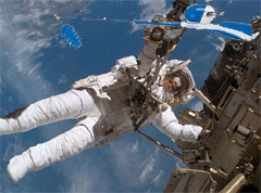 Astronaut Chrissie Buglebong attaches prototype rod and reel device during a dry run simulation